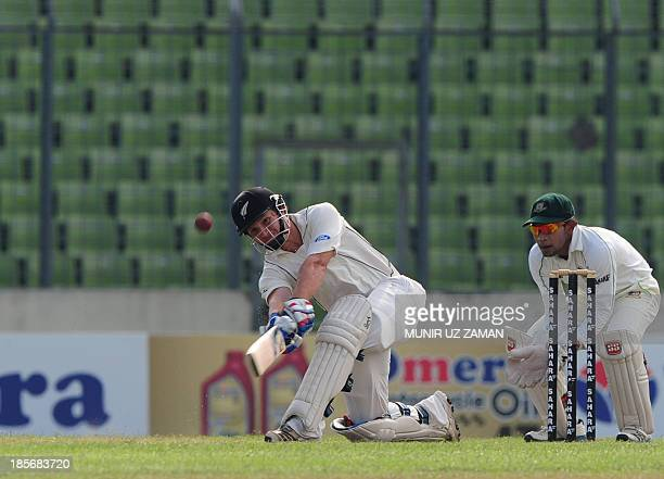 New Zealand batsman B J Walting plays a shot as Bangladesh cricket captain Mushfiqur Rahim looks on during the fourth day of the second cricket Test...