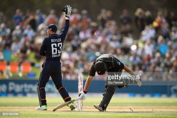 New Zealand batsman Colin de Grandhomme is run out by Jonny Bairstow as Jos Buttler appeals during the 2nd ODI between New Zealand and England at Bay...