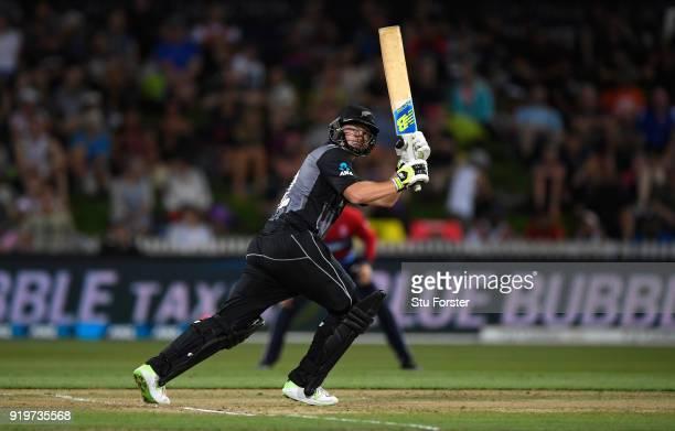 New Zealand batsman Colin Munro hits a six during the International Twenty20 match between New Zealand and England at Seddon Park on February 18 2018...