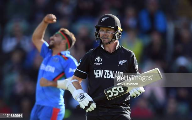 New Zealand batsman Colin Munro leaves the field after being dismissed by Afghanistan bowler Aftab Alamduring the Group Stage match of the ICC...
