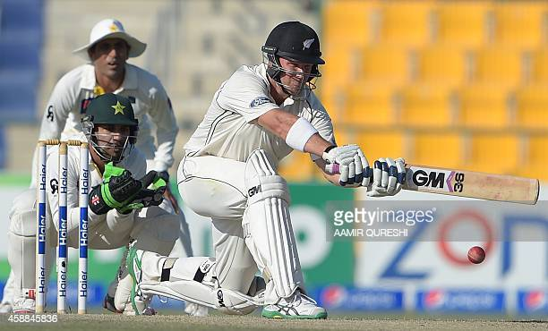 New Zealand batsman Corey Anderson plays a shot as Pakistani wicketkeeper Sarfraz Ahmed looks on during the fourth day of the first Test match...