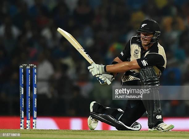 New Zealand batsman Corey Anderson plays a shot during the World T20 cricket tournament match between India and New Zealand at The Vidarbha Cricket...