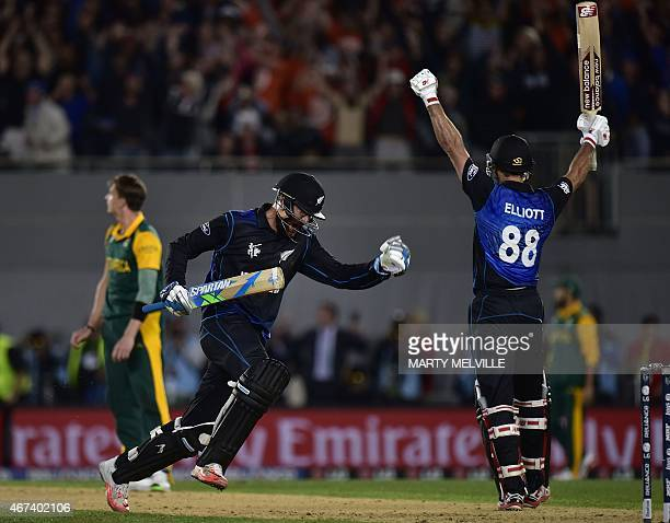 New Zealand batsman Daniel Vettori celebrates with teammate Grant Elliott after their team won the Cricket World Cup semifinal match between New...