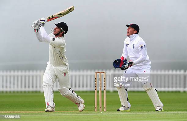 New Zealand batsman Hamish Rutherford hits a six watched by England wicketkeeper Jonathan Bairstow during day one of the tour match between England...