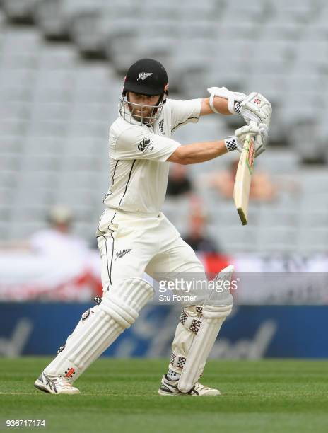 New Zealand batsman Kane Williamson reaches his century with a fine cut down to third man during day two of the First Test Match between the New...