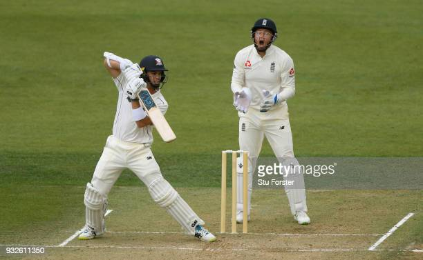 New Zealand batsman Mark Chapman hits out as England wicketkeeper Jonny Bairstow reacts during day one of the Test warm up match between England and...