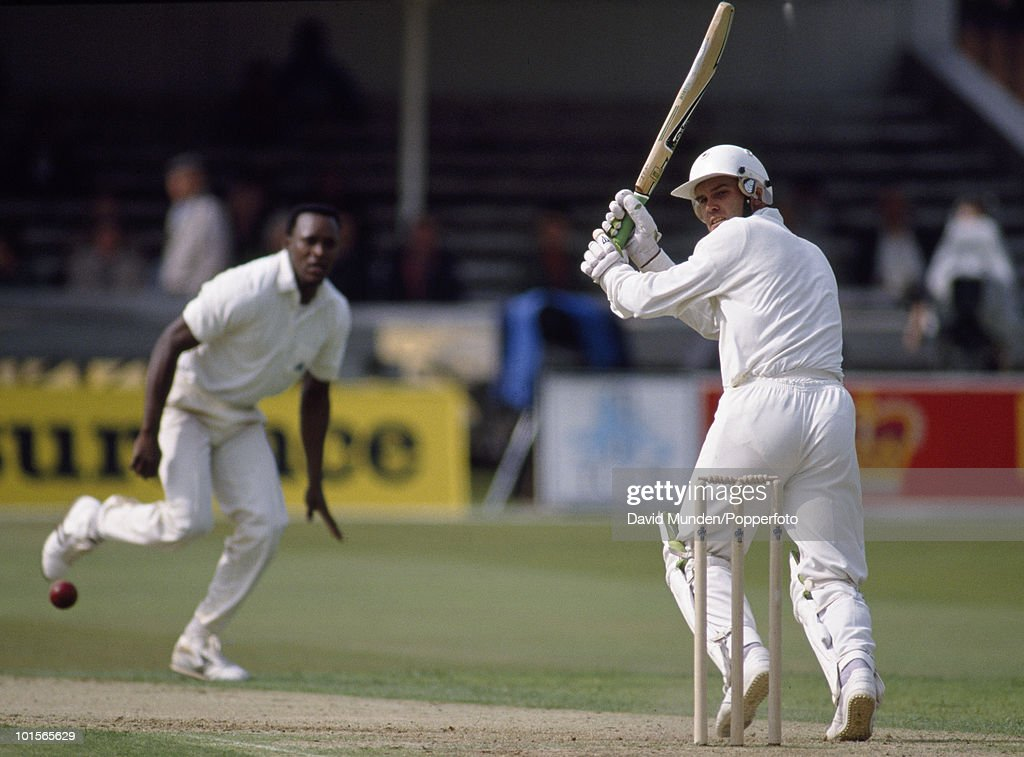 New Zealand batsman Martin Crowe plays a ball from England paceman Devon Malcolm on the first day of the 1st Test Match between England and New Zealand at Trent Bridge in Nottingham, 7th June 1990. The match ended in a draw.