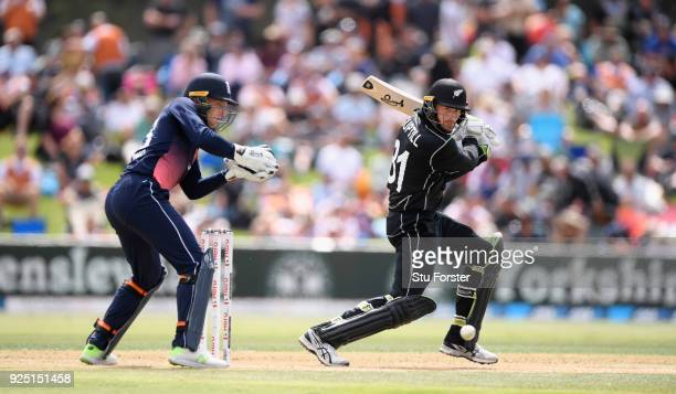 New Zealand batsman Martin Guptill cuts a ball to the boundary watched by Jos Buttler during the 2nd ODI between New Zealand and England at Bay Oval...