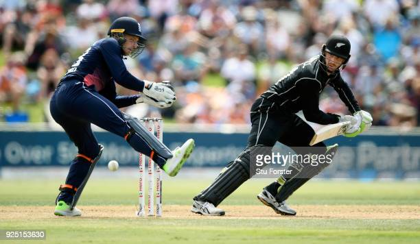 New Zealand batsman Martin Guptill cuts a ball towards the boundary watched by Jos Buttler uring the 2nd ODI between New Zealand and England at Bay...