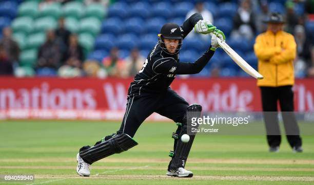 New Zealand batsman Martin Guptill drives to the boundary during the ICC Champions Trophy match between New Zealand and Bangladesh at SWALEC Stadium...