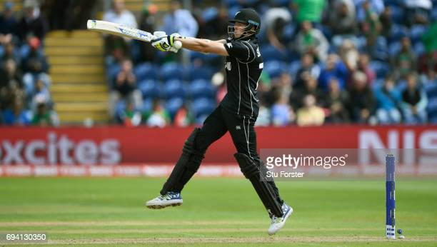 New Zealand batsman Mitchell Santner hits out during the ICC Champions Trophy match between New Zealand and Bangladesh at SWALEC Stadium on June 9...