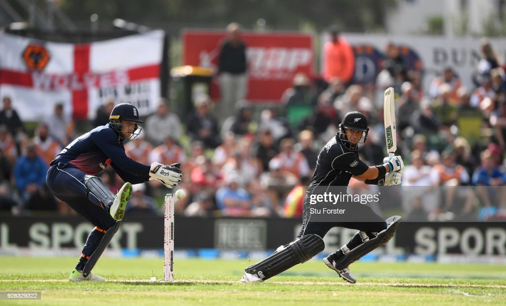 New Zealand batsman Ross Taylor hits out watched by Jos Buttler during the 4th ODI between New Zealand and England at University of Otago Oval on March 7, 2018 in Dunedin, New Zealand.