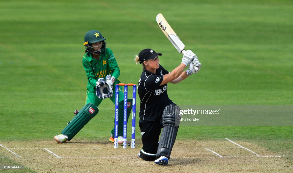 New Zealand batsman Sophie Devine hits a six watched by Pakistan wicketkeeper Sidra Nawaz during the ICC Women's World Cup 2017 match between New Zealand and Pakistan at The Cooper Associates County Ground on July 8, 2017 in Taunton, England.