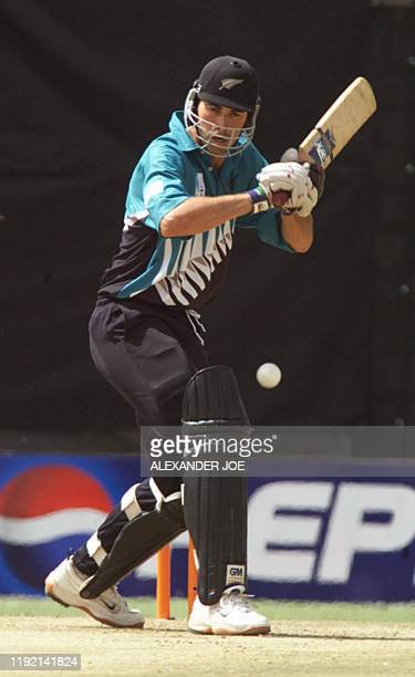 New Zealand batsman Stephen Fleming swings his bat to return the ball back to Zimbabwean bowler Henry Olanga during their match on the 6th day of the...