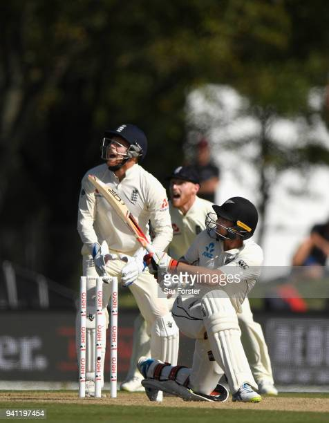 New Zealand batsman Tom Latham hits out watched by Jonny Bairstow and Ben Stokes only to be caught by James Vince during day five of the Second Test...