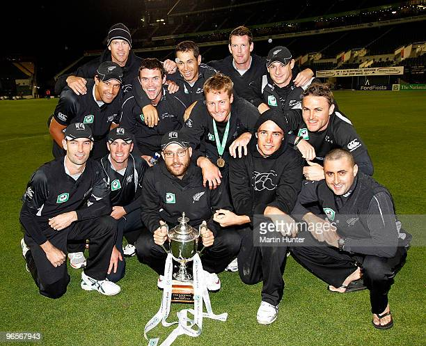 New Zealand Black Caps celebrate with the National Bank One Day Cup after the third One Day International match between the New Zealand Blacks Caps...