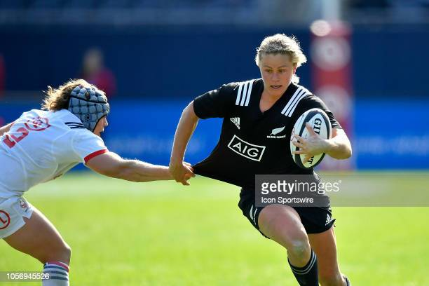New Zealand Black Ferns inside center Chelsea Alley avoids the tackle from USA Eagles hooker Kathryn Augustyn on November 3 2018 at Soldier Field in...