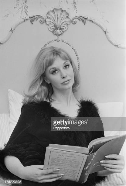 New Zealand born actress Nyree Dawn Porter reads an autobiography titled 'My Life in Art' by Konstantin Stanislavski in bed at home in England in...