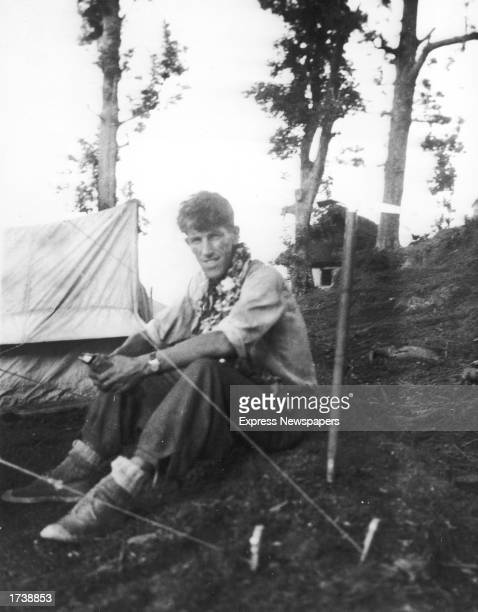 New Zealand born mountaineer Sir Edmund Hillary sits at base camp preparing for his successful attempt to be the first to reach the summit of Mount...