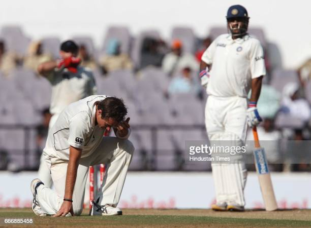 New Zealand bowler Andy McKay looks in disgust after his LBW appeal against Indian batsman MS Dhoni is turned down on the second day of the third...