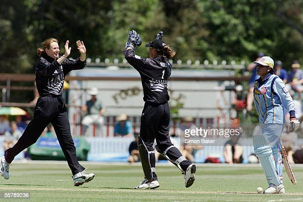 New Zealand bowler Clare Nicholsonleftcelebrates with keeper Rebecca Rolls after bowling out India's Kanojiarightfor a duck during the semi final of...