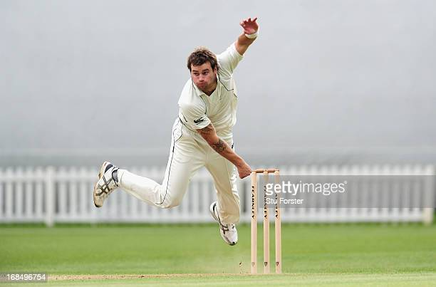 New Zealand bowler Doug Bracewell delivers during day two of the tour match between England Lions and New Zealand at Grace Road on May 10 2013 in...