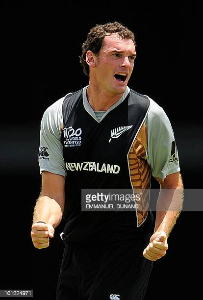 New Zealand bowler Kyle Mills celebrates after taking the wicket of Pakistani batsman Umar Akmal during the ICC World Twenty20 Super Eight match...