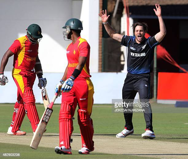 New Zealand bowler Mitchell McClenaghan celebrates the wicket of Hamilton Masakadza during the second game in a series of three One Day International...