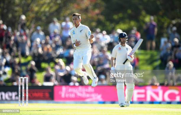 New Zealand bowler Trent Boult celebrates bowling Alastair Cook during day one of the Second Test Match between the New Zealand Black Caps and...