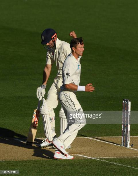 New Zealand bowler Trent Boult celebrates the wicket of Alastair Cook during day four of the First Test Match between the New Zealand Black Caps and...