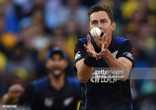 New Zealand bowler Trent Boult takes a catch off his own bowling to dismiss Australian batsman Aaron Finch during the 2015 Cricket World Cup final...