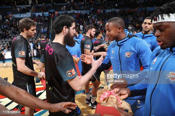 New Zealand Breakers and Oklahoma City Thunder shakes hands before the game during the preseason on October 10, 2019 at Chesapeake Energy Arena in...