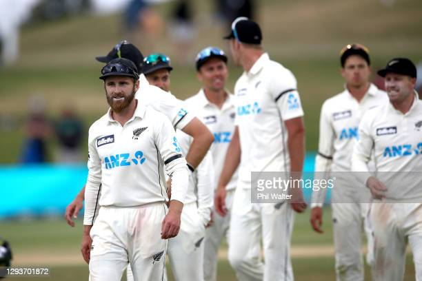 New Zealand captain and man of the match Kane Williamson leaves the field following day five of the First Test match in the series between New...