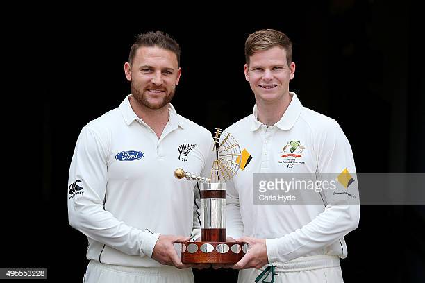 New Zealand captain Brendon McCullum and Australian captain Steve Smith hold the TransTasman Trophy during the joint Australian and New Zealand press...