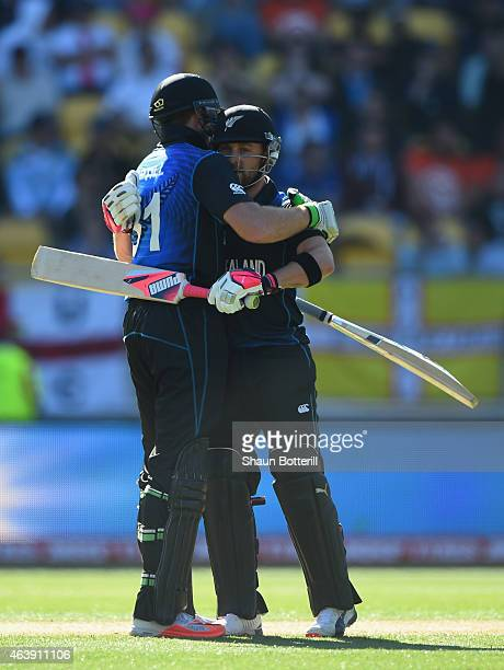 New Zealand captain Brendon McCullum embraces teammate Martin Guptil after reaching their 100 partnership during the 2015 ICC Cricket World Cup match...