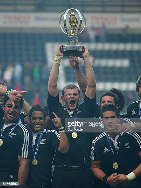 New Zealand captain Chris Smith holds aloft the trophy after their 38-3 defeat of England at the IRB Junior World Championship Final game between New...