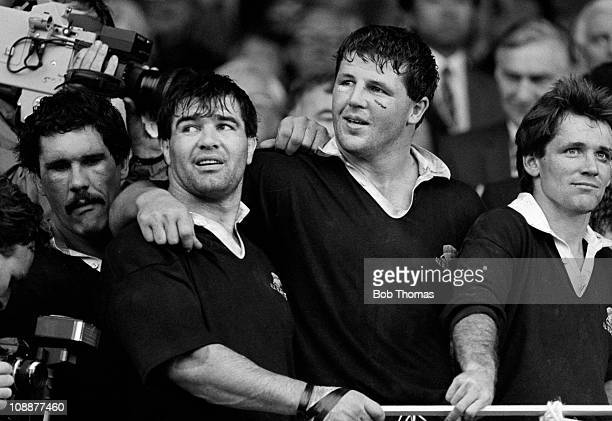 New Zealand captain David Kirk with teammates Steve McDowell and Sean Fitzpatrick wait the trophy presentation after the New Zealand v France Rugby...