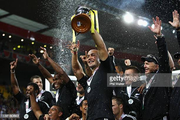 New Zealand captain DJ Forbes holds up the trophy after winning the Cup Final against Fiji on day two of the Wellington Sevens at Westpac Stadium on...