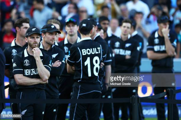 New Zealand Captain Kane Williamson and his teammates look dejected after defeat during the Final of the ICC Cricket World Cup 2019 between New...