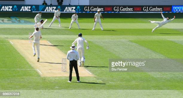 New Zealand captain Kane Williamson dives to catch England batsman Stuart Broad off the bowling of Tim Southee during the First Test Match between...
