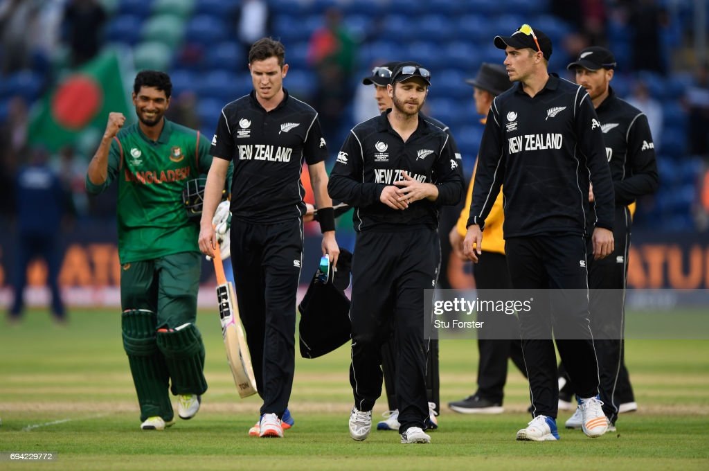 New Zealand captain Kane Williamson leads his team off the field as Bangladesh batsman Mahmudullah celebrates victory after the ICC Champions Trophy match between New Zealand and Bangladesh at SWALEC Stadium on June 9, 2017 in Cardiff, Wales.