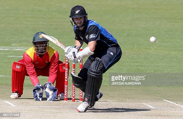 New Zealand captain Kane Williamson plays a shot as Zimbabwe wicketkeeper Regis Chakabva looks on during the first in a series of three One Day...