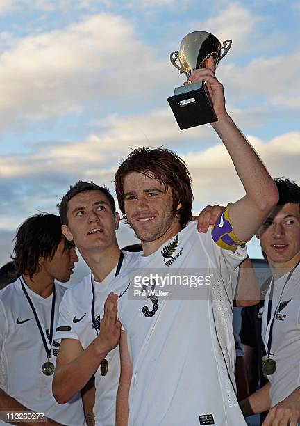 New Zealand captain Nick Branch celebrates his teams win following the Oceania Under 20 Tournament final match between New Zealand and Solomon...