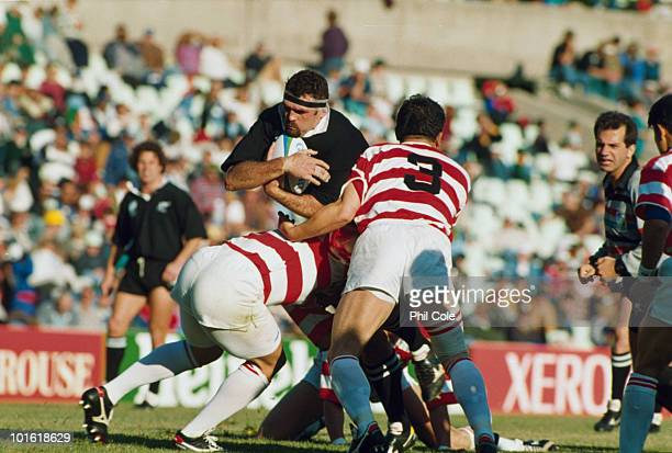 New Zealand captain Norm Hewitt takes on the Japanese defence during the pool stage game at the 1995 Rugby World Cup, the Free State Stadium,...