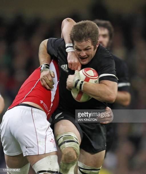 New Zealand captain Richie McCaw is tackled by Jonathan Thomas of Wales during the Autumn International rugby union match between Wales and New...