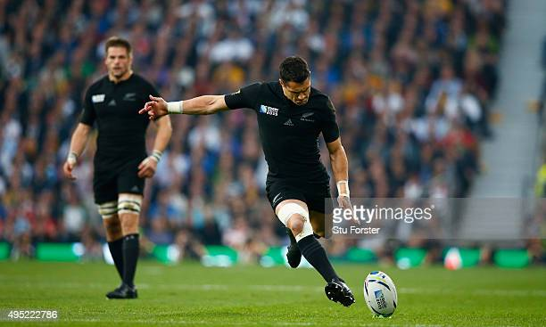 New Zealand captain Richie McCaw looks on as Dan Carter kicks a penalty during the 2015 Rugby World Cup Final match between New Zealand and Australia...