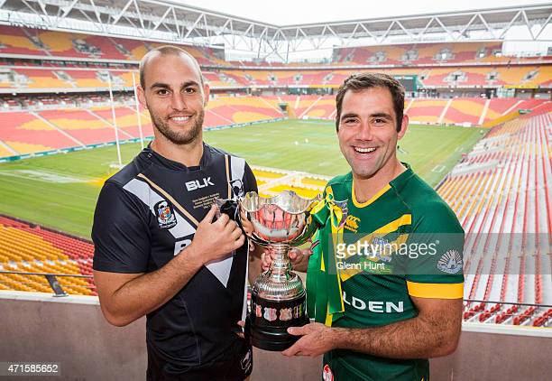 New Zealand captain Simon Mannering and Australian captain Cameron Smith pose with trophy ahead of the International Test match during a press...