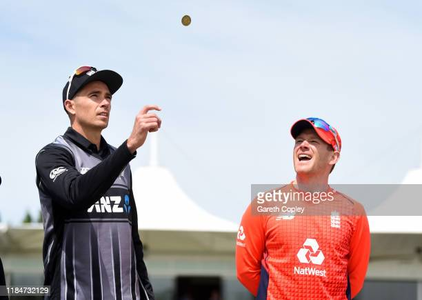 New Zealand captain Tim Southee tosses the coin alongside England captain Eoin Morgan ahead of game one of the Twenty20 International series between...