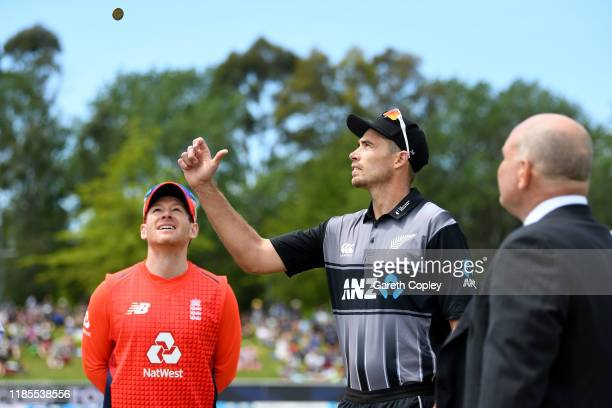 New Zealand captain Tim Southee tosses the coin alongside England captain Eoin Morgan ahead of game three of the Twenty20 International series...