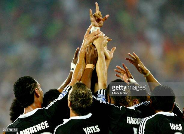 New Zealand celebrate after winning the Cup Final against Samoa in the New Zealand International Sevens at Westpac Stadium on February 2 2008 in...
